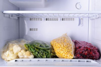 Los Angeles Sub zero refrigerator repair - Frozen berries and vegetables in bags in freezer close up