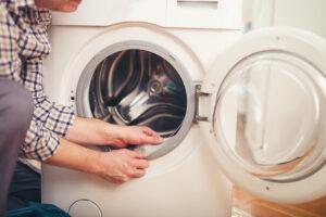 Las Vegas Aski repair - Technician repairing a washing machine at home