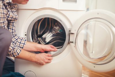 Las Vegas Aski repair - Technician repairing a washing machine at home