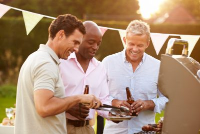 Los Angeles Wolf appliance repair - Mature Male Friends Enjoying Outdoor Summer Barbeque