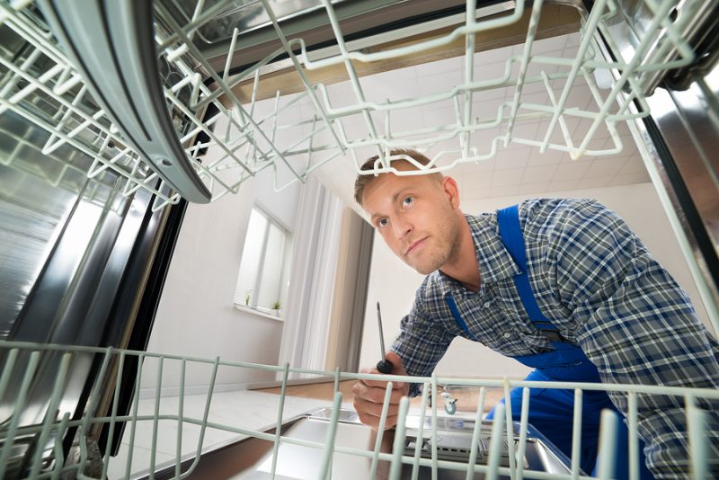 Santa Monica Asko dishwasher repair - Photo Of Male Technician Repairing Dishwasher With Screwdriver