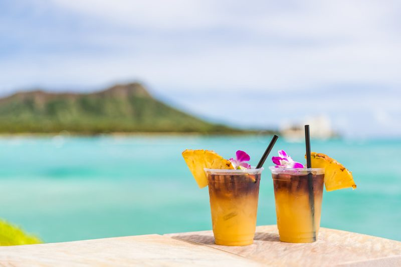 Palm Springs sub zero refrigerator servicing - Hawaii mai tai drinks on waikiki beach bar travel vacation in Honolulu, Hawaii. Famous hawaiian drink cocktails with view of ocean and diamond head mountain, Hawaii tourist attraction.
