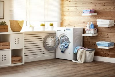 Palm Springs asko appliance repair - Interior of a real laundry room with a washing machine at the window at home