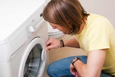 man using the washing machine