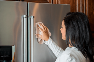 woman-cleaning-refrigerator
