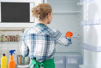 Woman-Gloves-Cleaning-Refrigerator