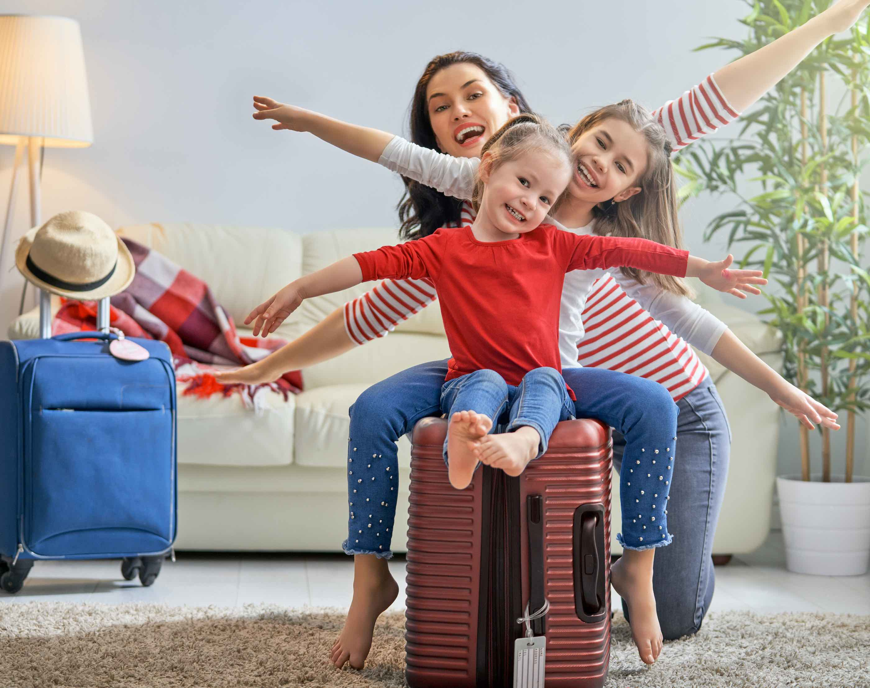 family-luggage-in-living-room-preparing-for-vacation-holidays