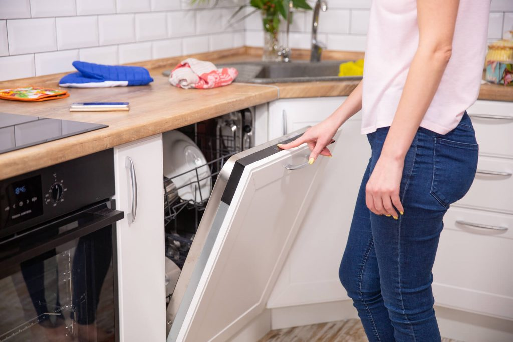 Clean-Dishes-In-The-Dishwasher-Run-woman-in-jeans
