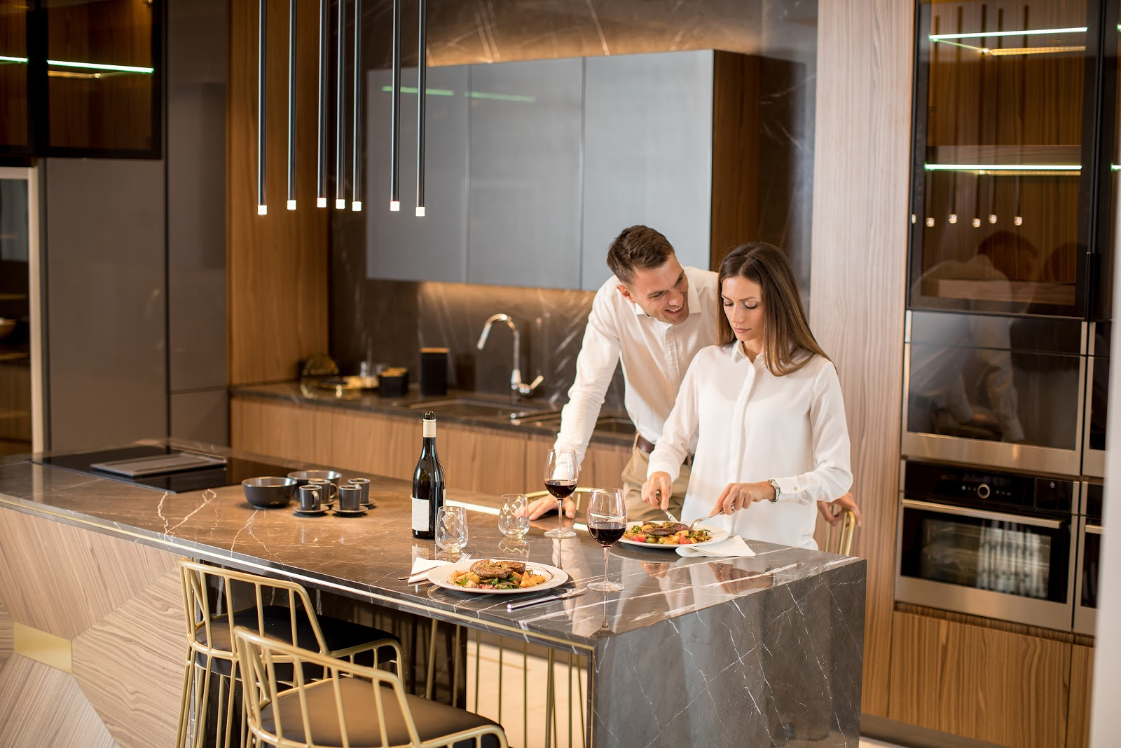 Sweet-Couple-Having-A-Romantic-dinner-wolfe-appliance-in-kitchen
