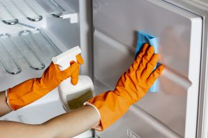 Cleaning-refrigerator-with-household-cleaning-products